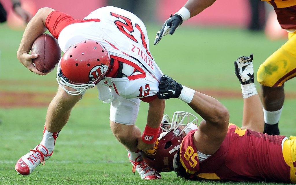 . Southern California defensive end J.R. Tavai (58) sacks Utah quarterback Adam Schulz (12) during the second half of an NCAA college football game in the Los Angeles Memorial Coliseum in Los Angeles, on Saturday, Oct. 26, 2013. Southern California won 19-3.   (Photo by Keith Birmingham/Pasadena Star-News)