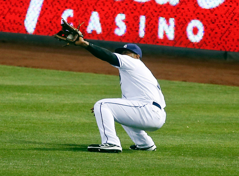 . San Diego Padres right fielder Rymer Liriano grabs a line drive hit by Colorado Rockies\' DJ LeMahieu in the second inning of a baseball game Monday, Aug. 11, 2014, in San Diego. (AP Photo/Lenny Ignelzi)