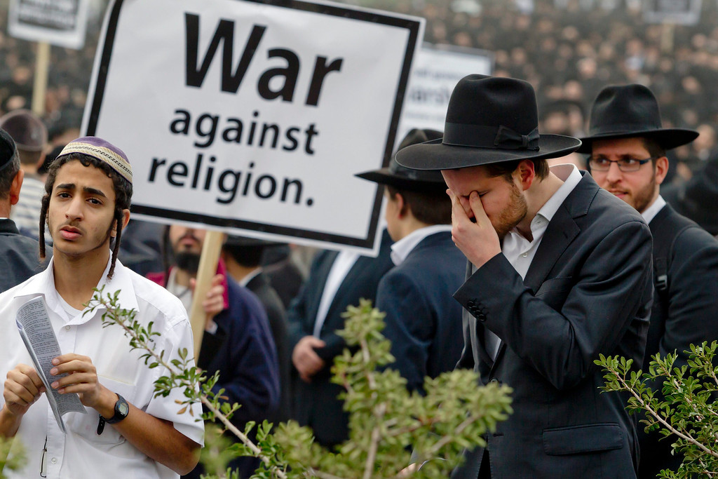 . Ultra-Orthodox Jews gather for a mass prayer in protest to the government\'s army conscription laws in Jerusalem, 02 March 2014. Police estimated the crowd to some 300,000 ultra-Orthodox turned out for the prayer.  EPA/JIM HOLLANDER