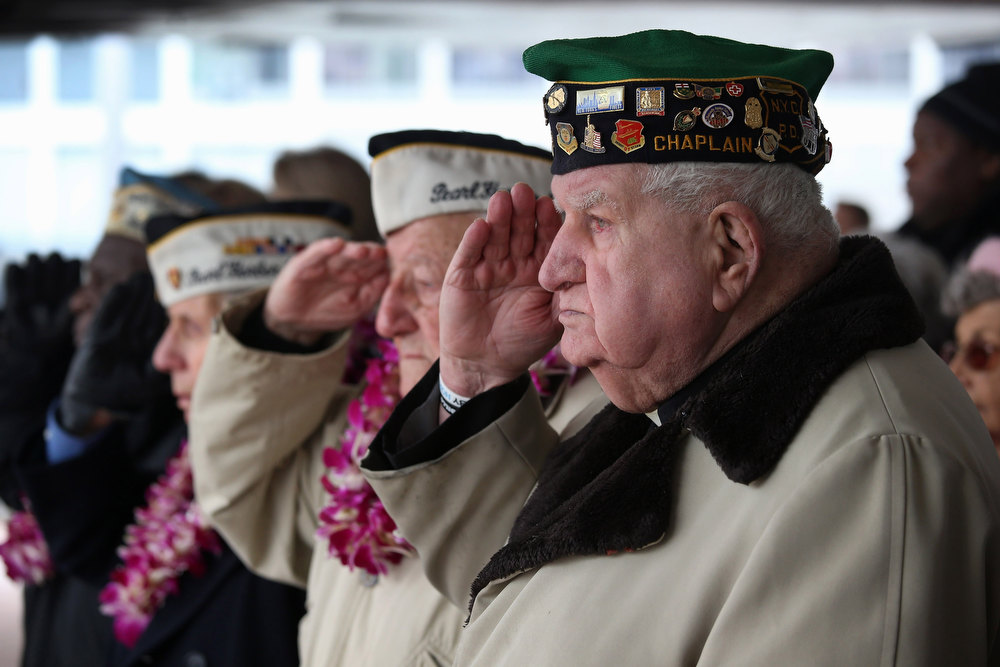 Description of . Pearl Harbor survivors attend a ceremony commemorating the 71st anniversary of the Japanese attacks on Pearl Harbor on December 7, 2012 in New York City. World War II veterans from the New York metropolitan area participated in a wreath-laying ceremony next to the Intrepid Sea, Air and Space Museum, which was damaged in Hurricane Sandy and is undergoing repairs.  (Photo by John Moore/Getty Images)
