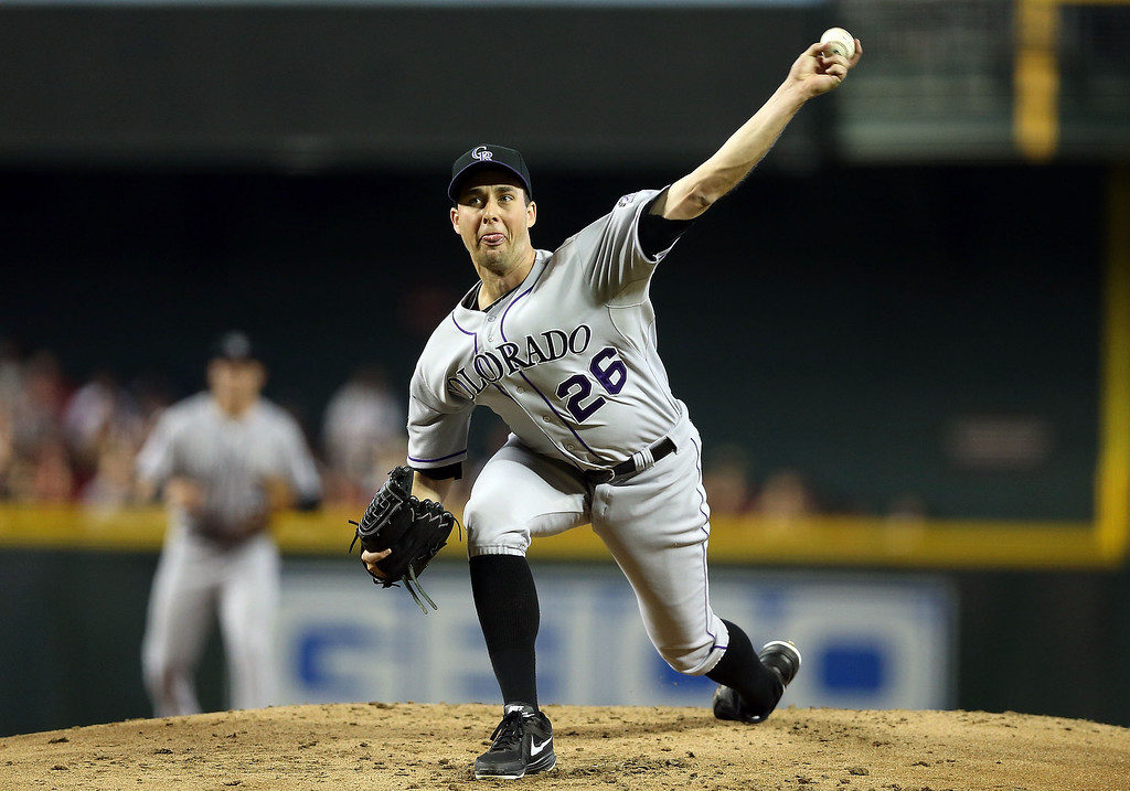 . Starting pitcher Jeff Francis #26 of the Colorado Rockies pitches against the Arizona Diamondbacks during the first inning of the MLB game at Chase Field on April 27, 2013 in Phoenix, Arizona.  (Photo by Christian Petersen/Getty Images)