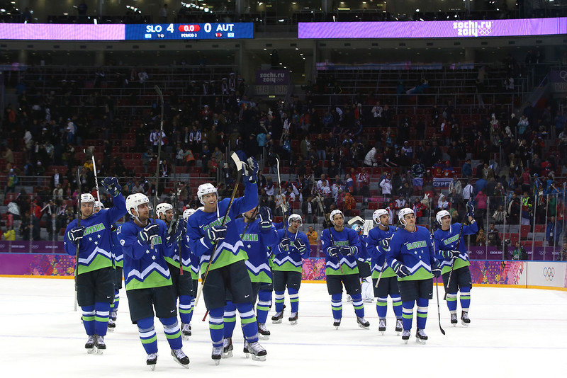 . Team Slovenia celebrates defeating Austria 4 to 0 in the Men\'s Ice Hockey Qualification Playoff game on day eleven of the Sochi 2014 Winter Olympics at Bolshoy Ice Dome on February 18, 2014 in Sochi, Russia.  (Photo by Bruce Bennett/Getty Images)