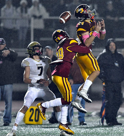 12/14/2019 Mike Orazzi | StaffrDaniel Hand's Seth Sweitzer (7) catches a tipped pass during a 17-13 St. Joseph win at Veteran's Stadium in New Britain on Saturday. ?.