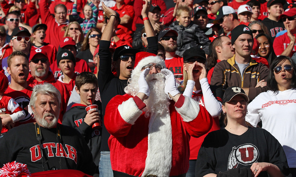 . A Utah fan dressed as Santa Claus shows his support in the first half during an NCAA college football game against Colorado Saturday, Nov. 30, 2013, in Salt Lake City. (AP Photo/Rick Bowmer)