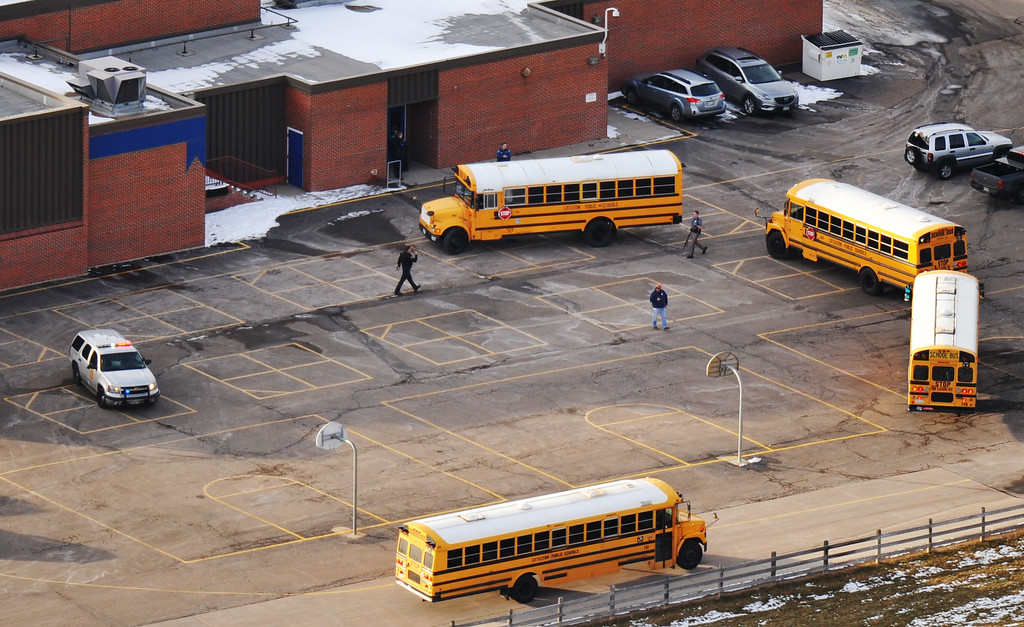 . LITTLETON, CO. DECEMBER 13: School bus parked by Euclid Middle School building one of the reunification centers following a shooting incident at Arapahoe High School in Centennial, Colorado,  December 13, 2013.(Photo by Hyoung Chang/The Denver Post)
