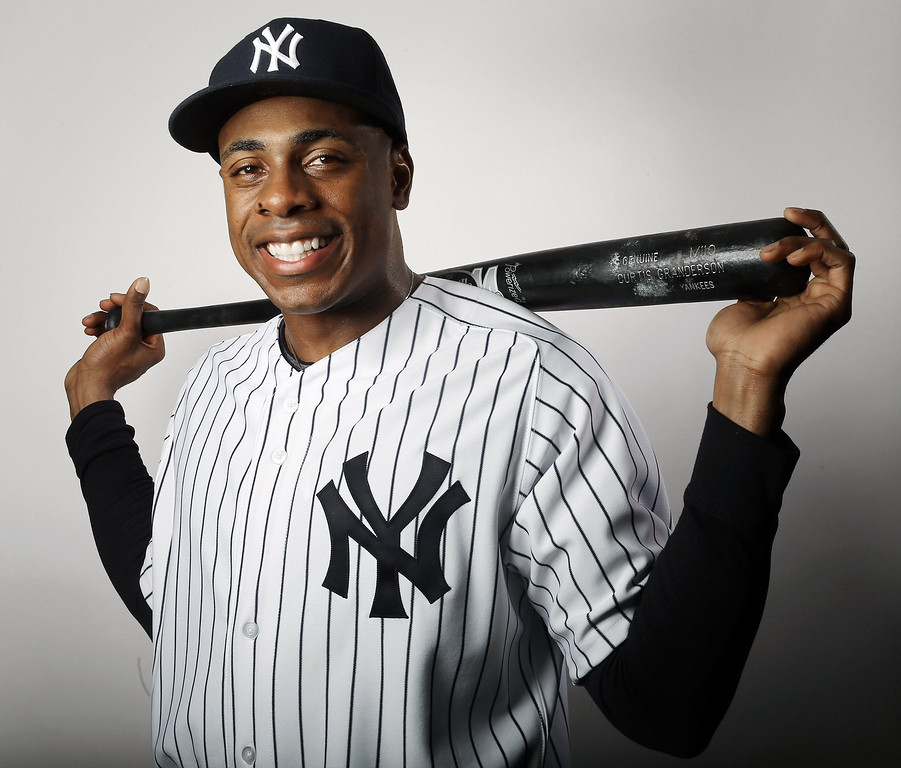 . TAMPA, FL - FEBRUARY 20:  Curtis Granderson #14 of the New York Yankees poses for a portrait on February 20, 2013 at George Steinbrenner Stadium in Tampa, Florida.  (Photo by Elsa/Getty Images)