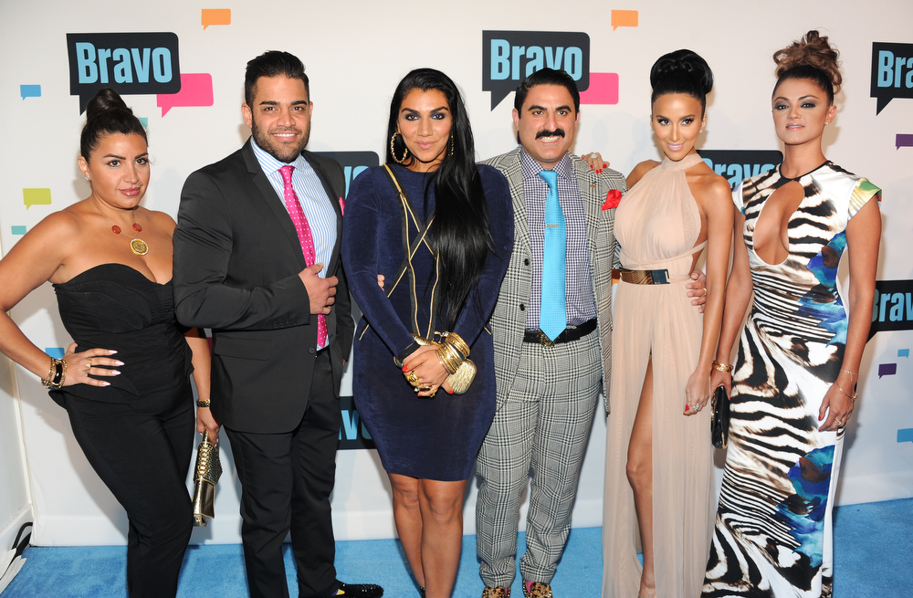 ". ""Shahs of Sunset\"" cast members, from left, Mercedes \""MJ\"" Javid, Mike Shouhed, Asa Soltan Rahmati, Reza Farahan, Lilly Ghalichi and Golnesa \""GG\"" Gharachedaghi attend the Bravo Network 2013 Upfront on Wednesday April 3, 2013 in New York. (Photo by Evan Agostini/Invision/AP)"