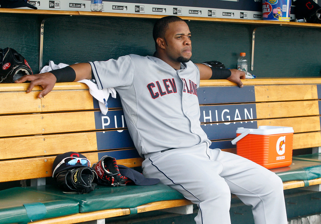 . Cleveland Indians\' Carlos Santana sits in the dugout during the ninth inning of a baseball game against the Detroit Tigers Sunday, June 14, 2015, in Detroit. Santana went 0-for-4 with a strikeout in the Indians 8-1 loss to the Tigers. (AP Photo/Duane Burleson)