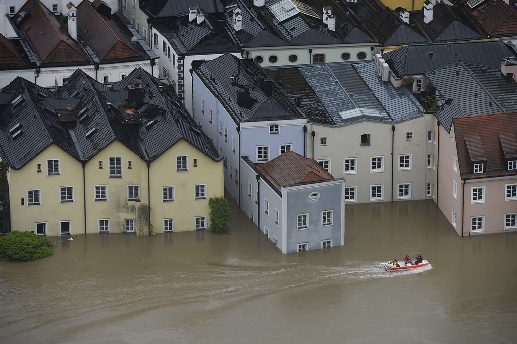 . Rescue workers on a boat pass through the flooded old city of Passau, southern Germany, on June 3, 2013. Due to heavy and ongoing rainfalls, parts of the southern state of Bavaria were flooded.   CHRISTOF STACHE/AFP/Getty Images