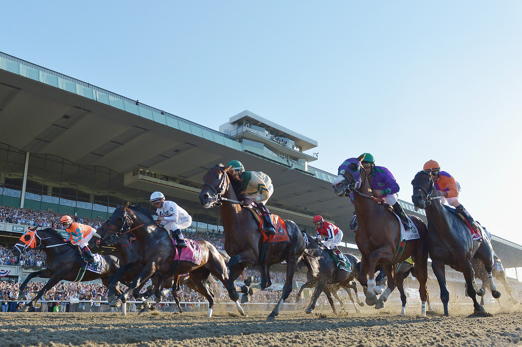 . ELMONT, NY - JUNE 07:  The field starts the 146th running of the Belmont Stakes at Belmont Park on June 7, 2014 in Elmont, New York.  (Photo by Drew Hallowell/Getty Images)