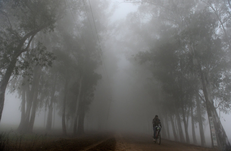 . An Indian man rides his bicycle during a dense fog along the India-Pakistan border in Suchit-Garh, 36 kms southwest of Jammu on January 10, 2013.   The beheading of an Indian soldier may have sparked a war of words between Delhi and Islamabad but the two nuclear rivals are both determined to prevent it from wrecking a fragile peace process.  Two Indian soldiers died after a firefight erupted in disputed Kashmir on Tuesday as a patrol moving in fog discovered Pakistani troops about 500 metres (yards) inside Indian territory, according to the Indian army.  TAUSEEF MUSTAFA/AFP/Getty Images