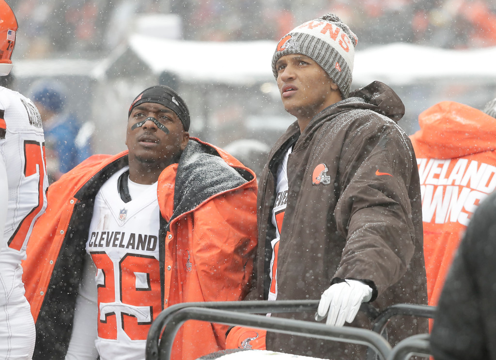 . Cleveland Browns running back Duke Johnson (29) and quarterback DeShone Kizer watch from the sidelines against the Chicago Bears in the first half of an NFL football game in Chicago, Sunday, Dec. 24, 2017. (AP Photo/Charles Rex Arbogast)