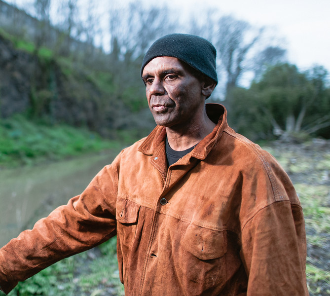 Indigenous Australian Man standing on a River Bank