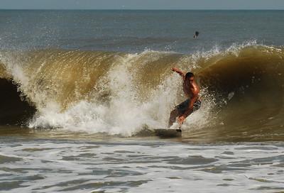 43: Surfing and Bikini clad sunbathers on Flagler Beach, Florida