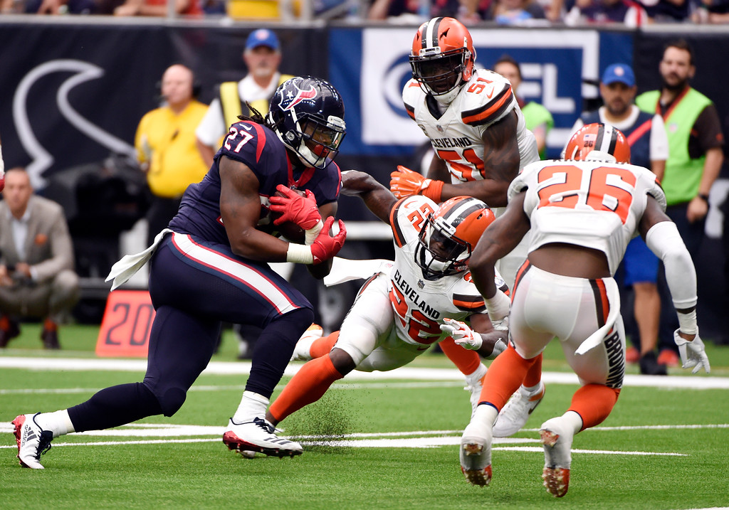 . Houston Texans running back D\'Onta Foreman (27) carries the ball as Cleveland Browns\' Jabrill Peppers (22), Jamie Collins Sr. (51) and Derrick Kindred (26) give chase in the second half of an NFL football game, Sunday, Oct. 15, 2017, in Houston. (AP Photo/Eric Christian Smith)