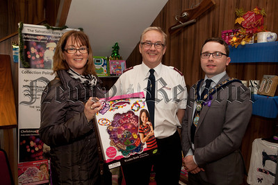 Majella Burns from Headway presents the first gifts for thsi years Salvation Army Christmas Family Appeal to Major John Parrott. Also pictured is Mayor Daire Hughes. R1448005