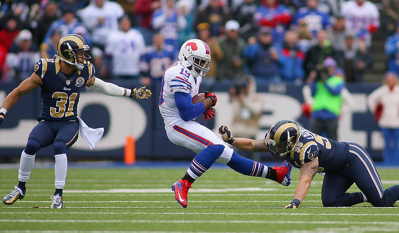 . Donald Jones #19 of the Buffalo Bills is hit after a catch by  James Laurinaitis #55 of the St. Louis Rams at Ralph Wilson Stadium on December 9, 2012 in Orchard Park, New York.  (Photo by Rick Stewart/Getty Images)
