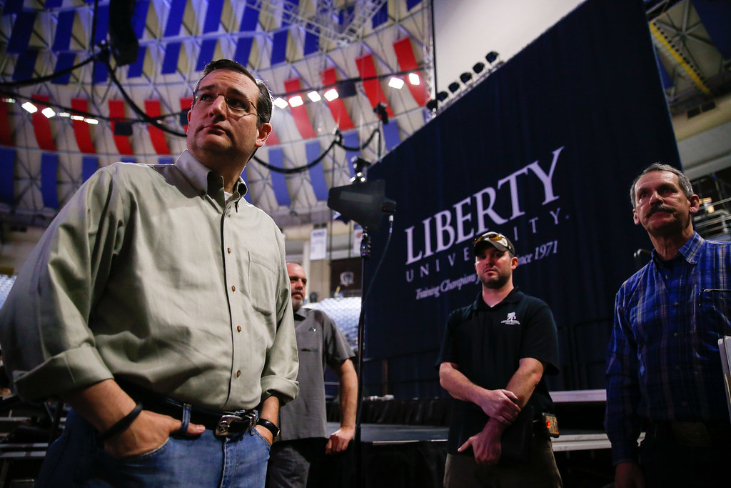 . Sen. Ted Cruz, R-Texas, left, meets with staff and coordinators during a walk-through for his Monday morning speech where he will launch his campaign for president of the United States at Liberty University on Sunday, March 22, 2015 in Lynchburg, Va. Cruz will be the first major candidate in the 2016 race for president. (AP Photo/Andrew Harnik)