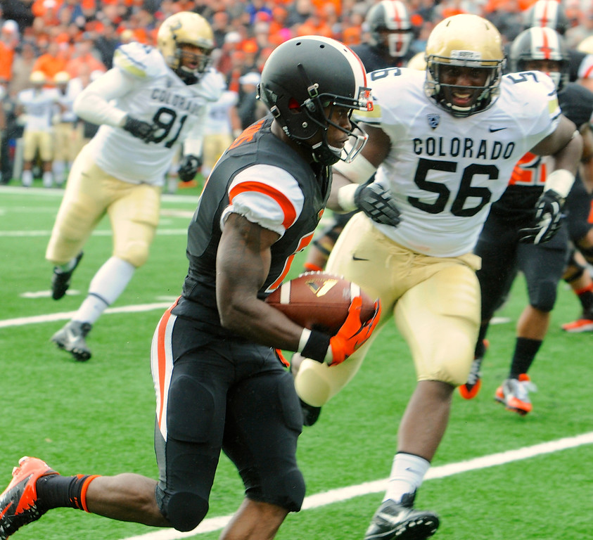 . Oregon State\'s Brandin Cooks (7) runs against Colorado\'s Juda Parker (56) in the first half of an NCAA college football game on Saturday, Sept 28, 2013,  in Corvallis, Ore. (AP Photo/Greg Wahl-Stephens)