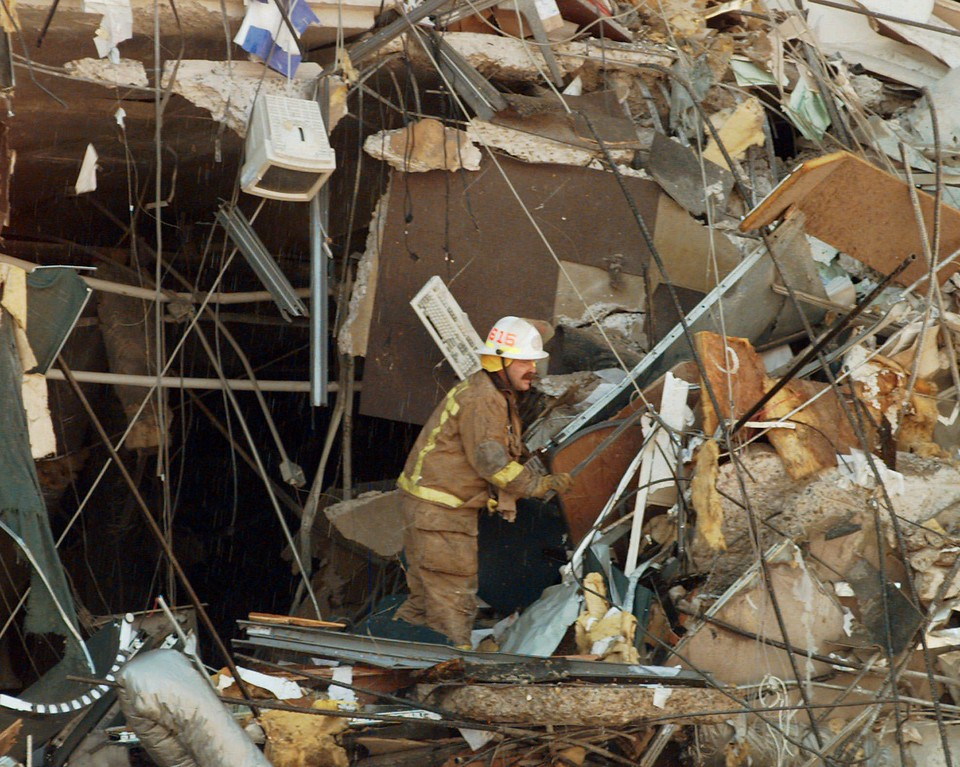 . Oklahoma City District Fire Chief Mike Shannon searches through the rubble of the bomb destroyed Alfred P. Murrah Federal Building moments after the explosion Wednesday April 19, 1995, in downtown Oklahoma City.  Shannon was one of the first to arrive on scene following the terrorist attack.  (AP Photo/David Longstreath)