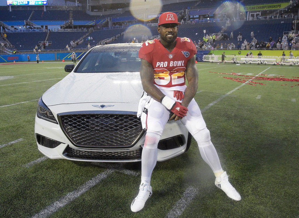 . AFC tight end Delanie Walker (82), of the Tennessee Titans, poses with the car he won for winning the MVP Offensive Player of the Game, at the NFL Pro Bowl football game, Sunday, Jan. 28, 2018, in Orlando, Fla. The AFC defeated the NFC 24-23. (AP Photo/Phelan M. Ebenhack)