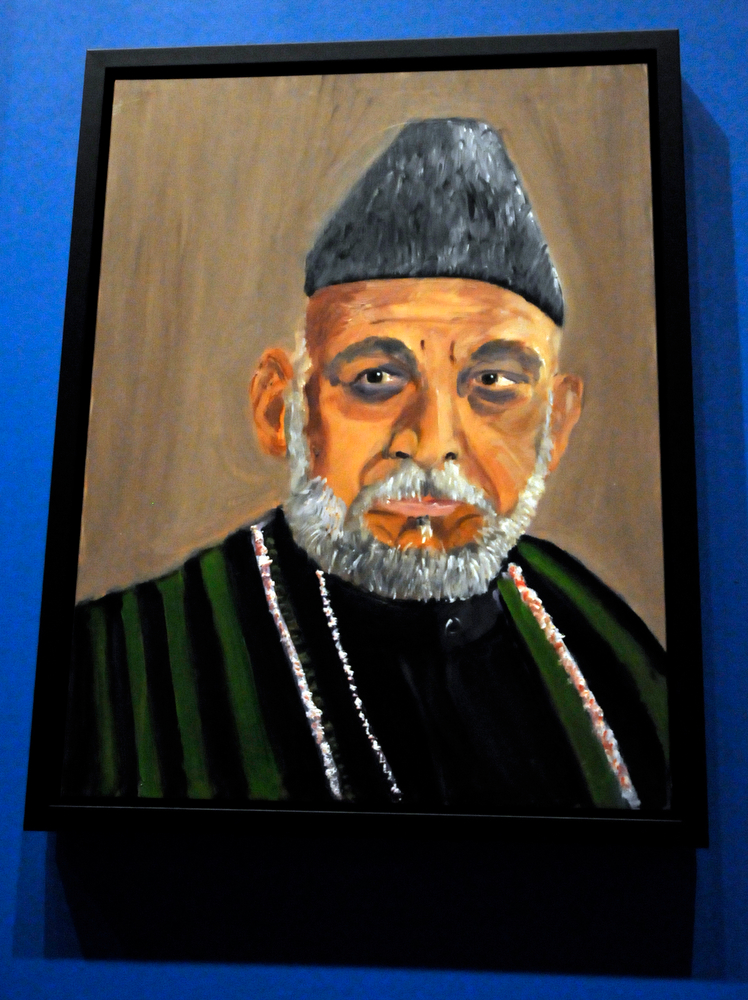 """. A portrait of Afghan President Hamid Karzai, which is part of the exhibit \""""The Art of Leadership: A President\'s  Diplomacy,\"""" is on display at the George W. Bush Presidential Library and Museum in Dallas, Friday, April 4, 2014. (AP Photo/Benny Snyder)"""