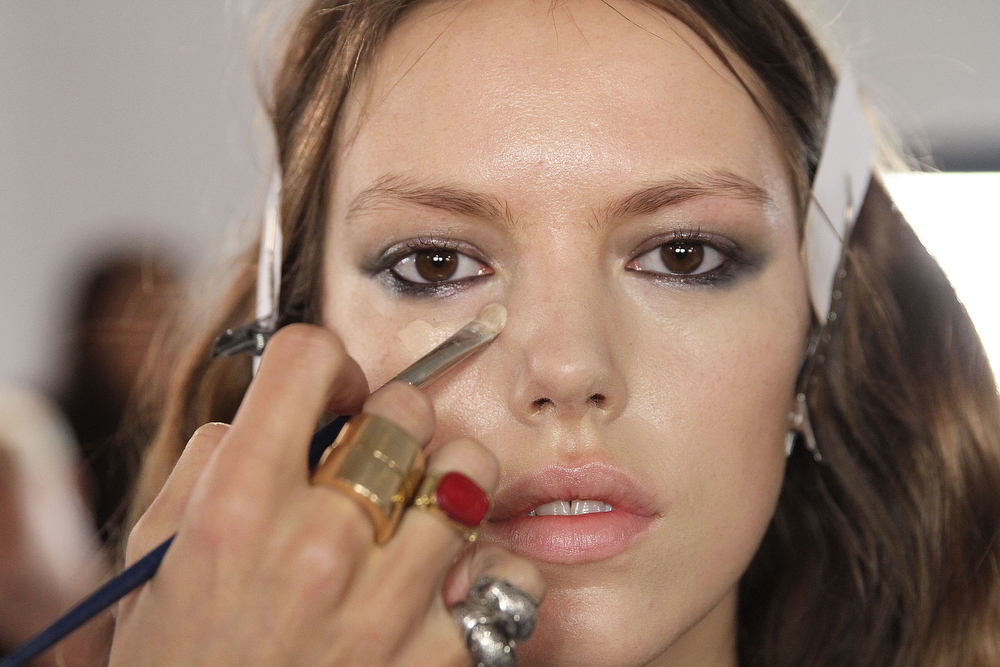 . A model gets makeup applied backstage at the Houghton fashion show during MADE Fashion Week fall 2014 at Milk Studios on February 6, 2014 in New York City.  (Photo by Mireya Acierto/Getty Images)