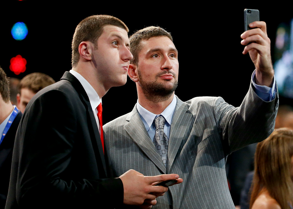 . NBA Draft prospects Jusuf Nurkic, of Bosnia, left, and Vasilije Micic, of Serbia, pose for a selfie before the start of the 2014 NBA draft, Thursday, June 26, 2014, in New York. Nurkic was the16th overall pick by the Chicago Bulls, and then was traded to the Denver Nuggets.  (AP Photo/Jason DeCrow)