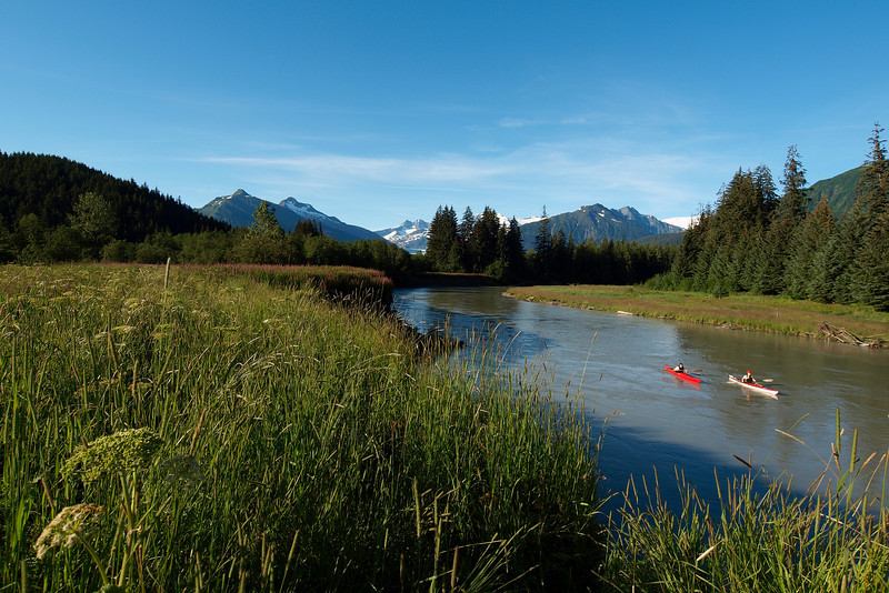 Kayakers enjoy a short float down the short Mendenhall River (maybe 4 miles from glacier to sea). July  8, 2010.