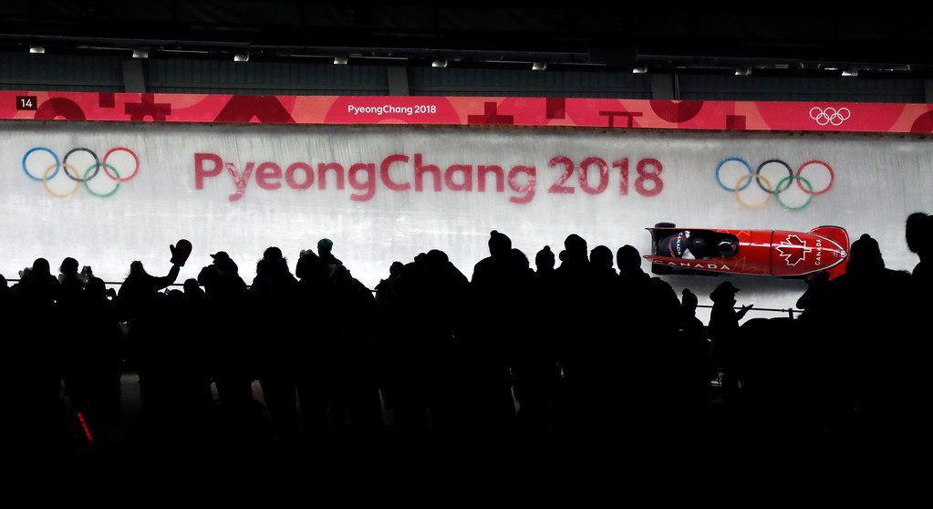 . Driver Christopher Spring and Lascelles Brown of Canada take a curve in the second run during the two-man bobsled competition at the 2018 Winter Olympics in Pyeongchang, South Korea, Sunday, Feb. 18, 2018. (AP Photo/Wong Maye-E)