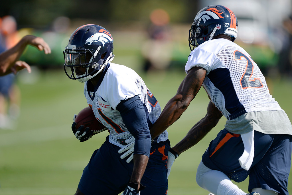 . Denver Broncos defensive back Charles Mitchell (41) runs through drills Denver Broncos strong safety Duke Ihenacho (27) during the first day of the Denver Broncos 2014 training camp July 24, 2014 at Dove Valley. (Photo by John Leyba/The Denver Post)