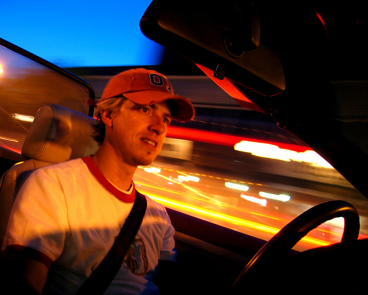 Trevor cruising with the top down in his Beamer along 17th Ave - taken handheld with point & shoot