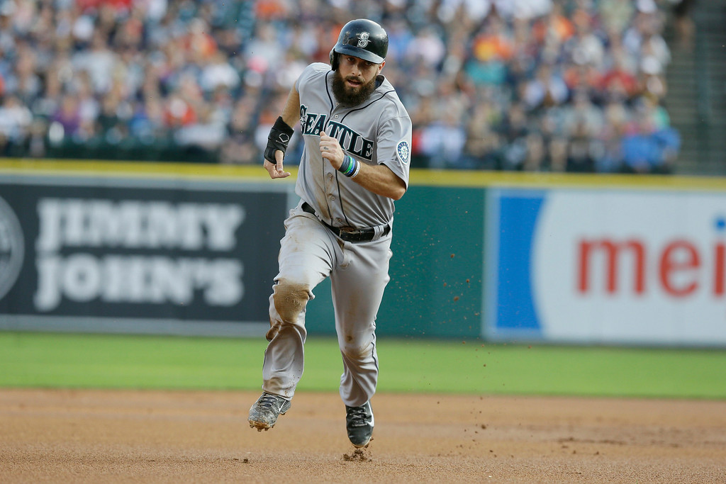 . Seattle Mariners\' Dustin Ackley runs to third during the first inning of a baseball game against the Detroit Tigers, Friday, Aug. 15, 2014 in Detroit. (AP Photo/Carlos Osorio)