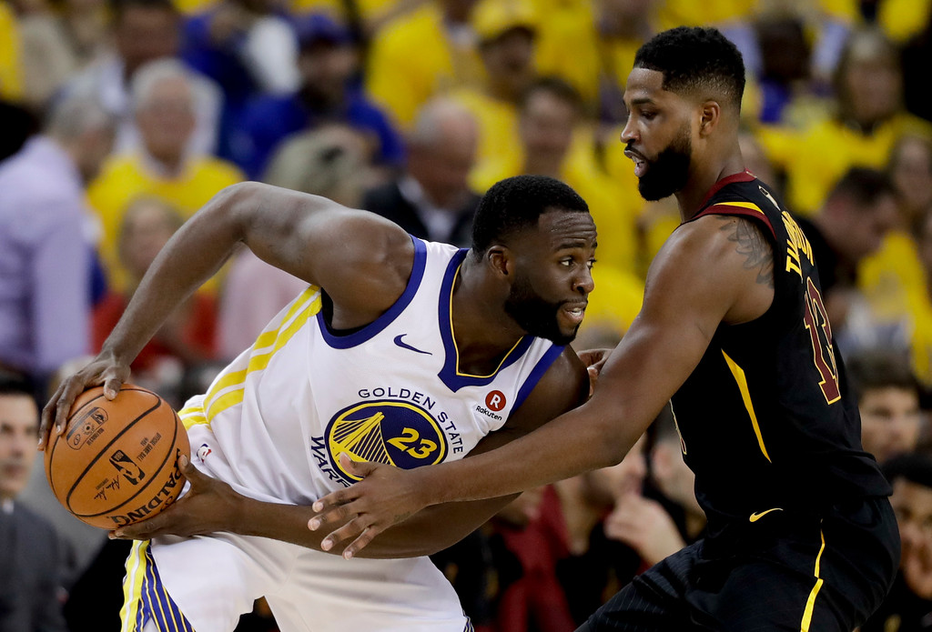 . Golden State Warriors forward Draymond Green (23) is defended by Cleveland Cavaliers center Tristan Thompson during the second half of Game 1 of basketball\'s NBA Finals in Oakland, Calif., Thursday, May 31, 2018. (AP Photo/Marcio Jose Sanchez)