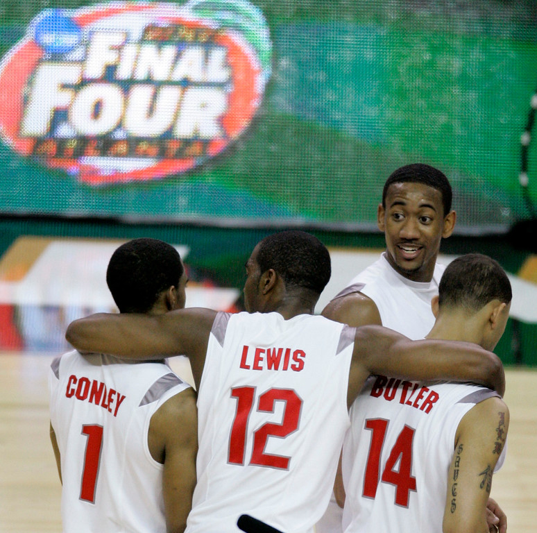 . Ohio State guard Mike Conley Jr. (1), Ron Lewis (12),  Jamar Butler (14),  David Lighty (23), from left, celebrate their 67-60 victory over Georgetown following  a Final Four semifinal basketball game at the Georgia Dome in Atlanta, Saturday, March 31, 2007. (AP Photo/Charlie Neibergall)