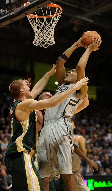. Buffs freshman forward Josh Scott (40) went to the hole with an offensive rebound in the second half. The University of Colorado men\'s basketball team defeated Colorado State University 70-61 at the Coors Events Center Wednesday night, November 5, 2012. Karl Gehring/The Denver Post