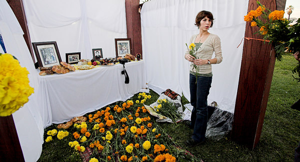 Marigolds (cempazuchitl) symbolized death to the Aztecs.  The strong ordor of the Marigold leads the dead back to their earthly home for a two day celebration in their honor.