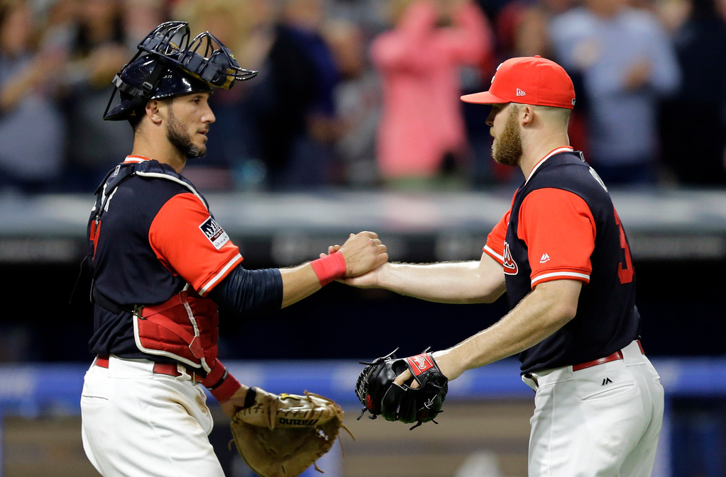 . Cleveland Indians relief pitcher Cody Allen, right, is congratulated by catcher Yan Gomes after the Indians defeated the Kansas City Royals 4-0 in a baseball game, Friday, Aug. 25, 2017, in Cleveland. (AP Photo/Tony Dejak)