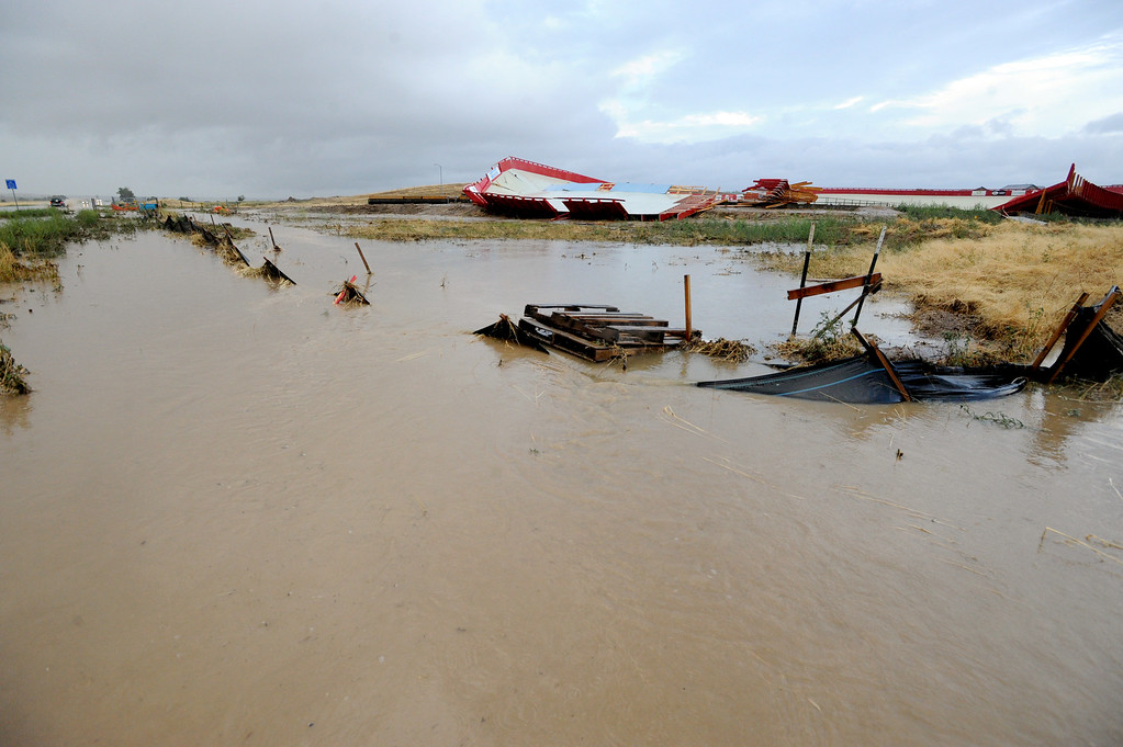 . Flood waters run along County Line Road, near the velodrome in Erie, Colorado on August 3, 2013. For more photos and videos of the storm damage, go to www.dailycamera.com. Cliff Grassmick  / August 3, 2013