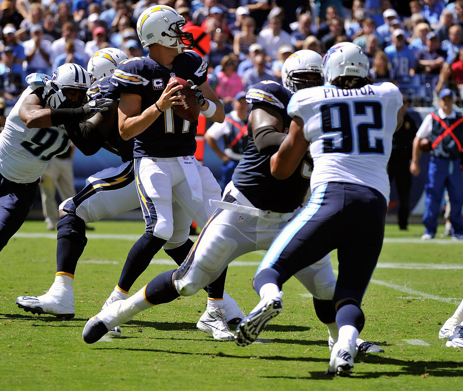 . Quarterback Philip Rivers #17 of the San Diego Chargers drops back against the Tennessee Titansat LP Field on September 22, 2013 in Nashville, Tennessee.  (Photo by Frederick Breedon/Getty Images)