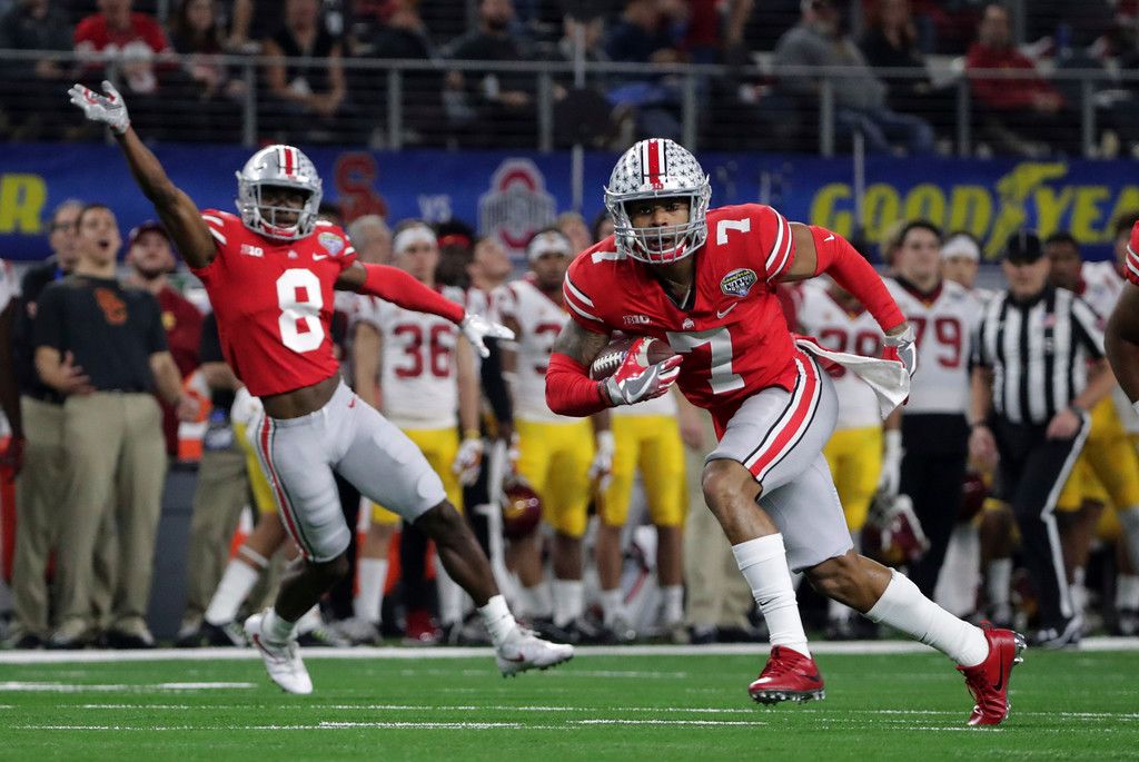 . Ohio State safety Damon Webb (7) runs an interception in for a touchdown in front of cornerback Kendall Sheffield (8) during the first half of the Cotton Bowl NCAA college football game against Southern California in Arlington, Texas, Friday, Dec. 29, 2017. (AP Photo/LM Otero)