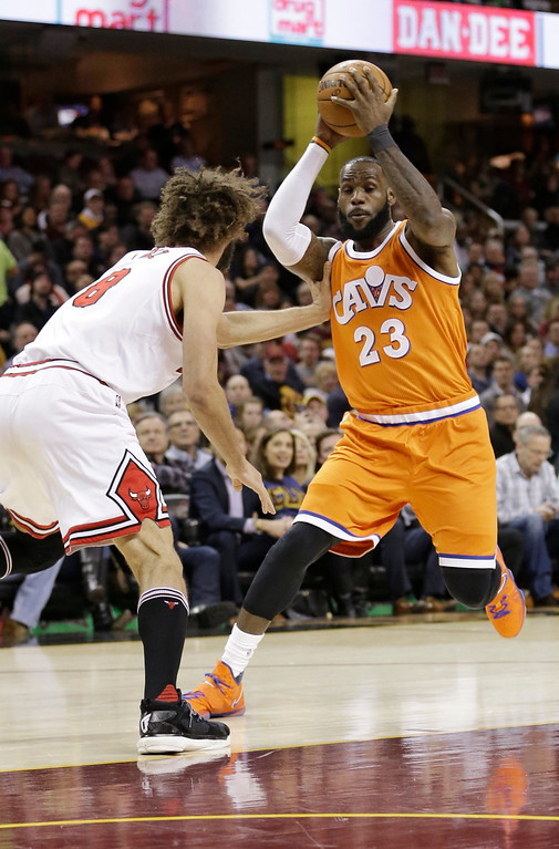 . Cleveland Cavaliers\' LeBron James (23) drives against Chicago Bulls\' Robin Lopez (8) in the first half of an NBA basketball game, Wednesday, Jan. 4, 2017, in Cleveland. (AP Photo/Tony Dejak)
