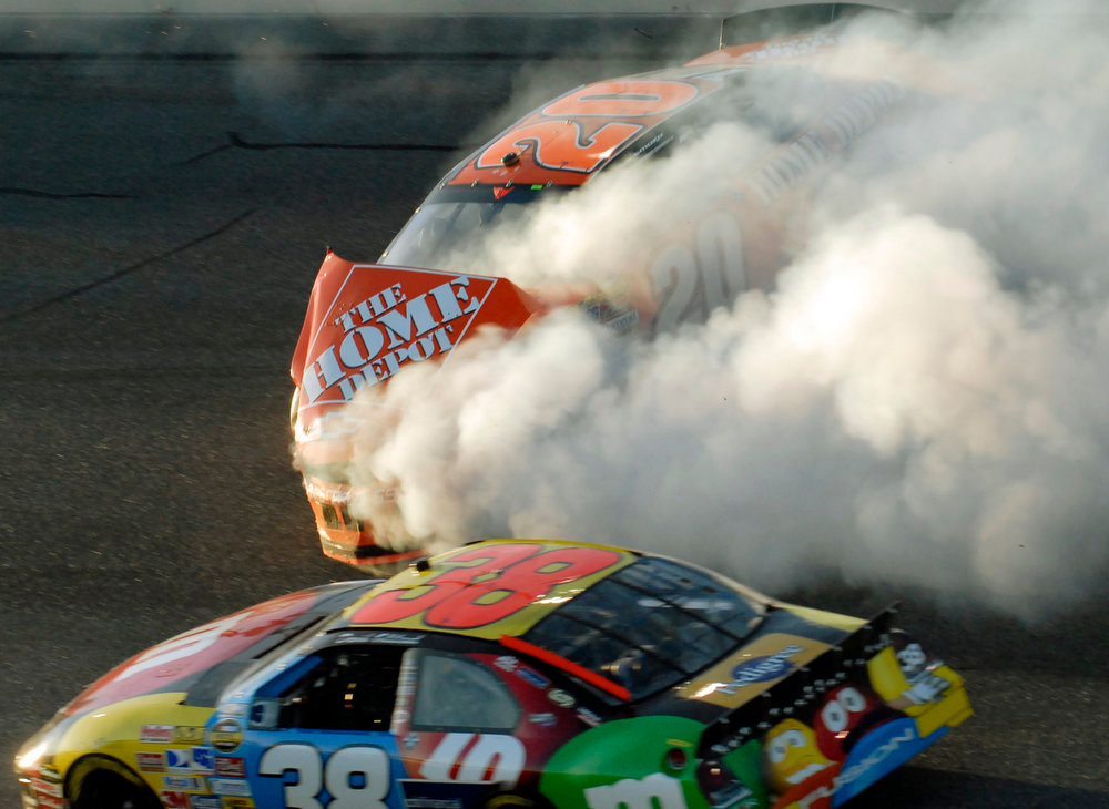 Description of . Daytona 500 pole sitter David Gilliland (38) avoids a spinning Tony Stewart after a wreck in the fourth turn during the Daytona 500 at Daytona International Speedway in Daytona Beach, Fla., Sunday, Feb. 18, 2007. (AP Photo/Paul Kizzle)