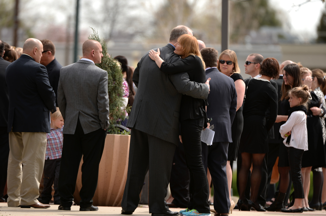 . People comfort each other in front of Most Precious Blood Catholic Church. (Photo by Hyoung Chang/The Denver Post)
