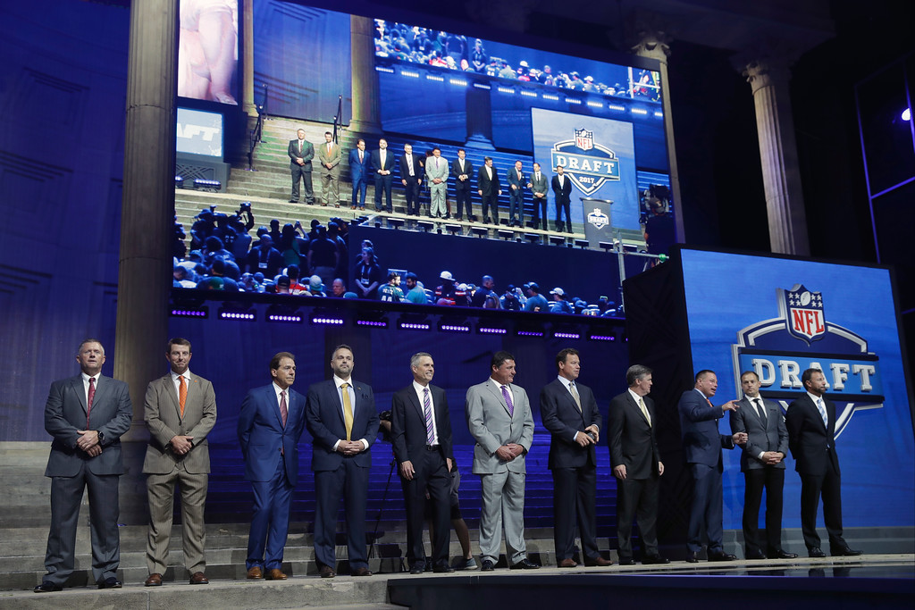 . College coaches pose before the first round of the 2017 NFL football draft, Thursday, April 27, 2017, in Philadelphia. (AP Photo/Matt Rourke)