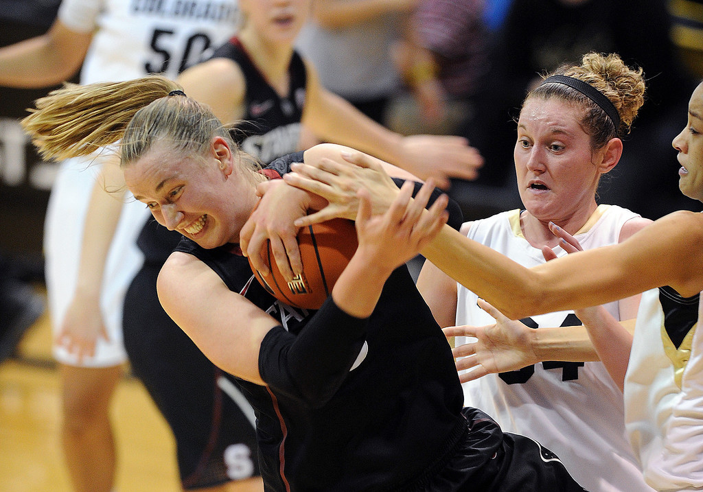 . Mikaela Ruef of Stanford rips the ball from Arielle Roberson and Jen Reese of CU during the second half of the January 12, 2014 game in Boulder. Cliff Grassmick/Daily Camera