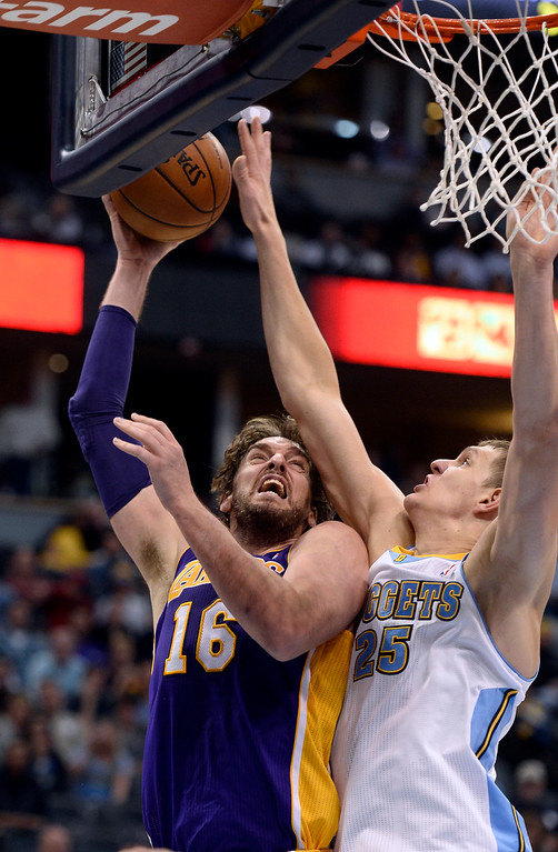 . DENVER, CO - NOVEMBER 13: Denver Nuggets center Timofey Mozgov (25) blocks a shot by Los Angeles Lakers center Pau Gasol (16) during the fourth quarter November 13, 2013 at Pepsi Center. (Photo by John Leyba/The Denver Post)