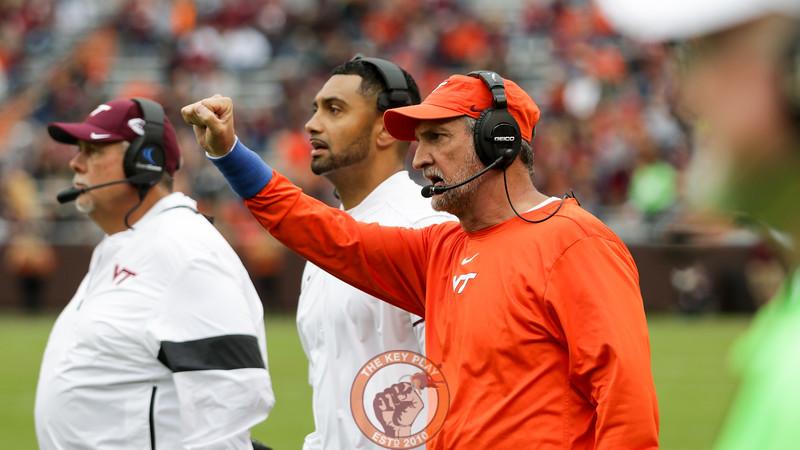 Defensive coordinator Bud Foster signals a play to his defense. (Mark Umansky/TheKeyPlay.com)