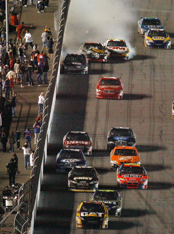 . David Gilliland, top left, crashes into Martin Truex Jr., center, and Greg Biffle during the NASCAR Budweiser Shootout auto race Saturday, Feb. 9, 2008, in Daytona Beach, Fla., at Daytona International Speedway. (AP Photo/Glenn Smith)