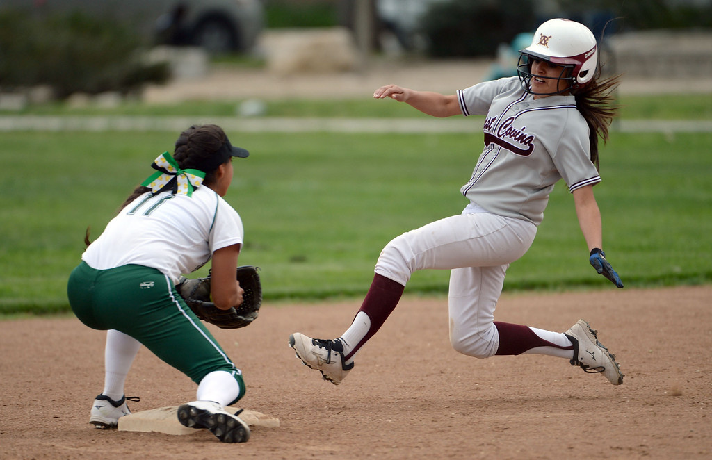 . Bonita shortstop Vienna Benavides (11) tags out West Covina\'s Miranda Gil on a attempted steal of second base in the fourth inning of a prep softball game at Los Flores Park in La Verne, Calif., on Thursday, March 27, 2014. Bonita won 6-3. (Keith Birmingham Pasadena Star-News)
